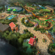 """It is unclear when Toy Story Land will open at Disney's Hollywood Studios, but the 11-acre space is sure to attract a host of new guests who will get to shrink down to the size of Buzz and Woody and explore Andy's backyard. Guests can even get a tour of Andy's """"bedroom"""" on the back of his plastic toy dog aboard family coaster, the Slinky Dog Dash."""