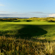 """Location: Troon, ScotlandThe current design of the Troon's Old Course dates back to 1923 and is considered the most difficult in the Open rotation. The sea views and punishing finish are a lure for golfers worldwide, but getting on the course itself isn't easy. It's only open to visitors on Mondays, Tuesdays and Thursdays, with green fees ranging from $250 per round in the cold months to upwards of $300 in the high season. That doesn't include the extra $45 to $51 you have to pay to play the secondary """"Portland"""" course, which is mandatory if you want to play the Old Course. That's a whole lot to part with just to struggle on that 577-hard sixth hole, but the honor is worth the humiliation."""