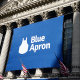Meal kit company Blue Apron Holdings Inc.finally goes public at the bottom end of its already-slashed IPO price, battered by concerns about the Amazon-Whole Foods tie-up. Shares closed Friday, its second day of trading, at $9.34, down 6.6%.
