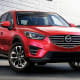 Starting price: $21,795Combined miles per gallon: 27.5Cargo capacity: 30.9 cubic feet with all seats up, 59.6 maximumMazda sells fewer than 300,000 cars here, which means most major automakers' midsize sedans outsell the entire Mazda line. However, its crossovers saw sales increase this year with help from this sporty little SUV.Under the hood is a 4-cylinder, 155-horsepower engine whose 30.5 combined mpg are every bit befitting a lightweight compact. However, it's the CX-5's in-car features that do the heavy lifting. The CX-5 is teeming with wheel-mounted controls, Bluetooth hands-free phone and audio streaming, HD radio, Pandora Internet radio and navigation system, pushbutton starter and three power outlets. The ample rear seating and up to 65.4 cubic feet of cargo space with the seats down aren't exactly throwaways, either.