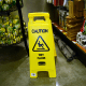 """What are those snakelike things on the floor below the disheveled display? Do they have to do with the """"Wet Floor"""" on the sign?"""