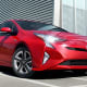 Starting price: $24,685Five-year cost to own: $36,366The original Prius still has the one thing everyone wants out of its brand -- incredible mileage -- but it's all of the Prius' perks that keep buyers coming back even as the efficient car market gets increasingly crowded.The latest incarnation of the Prius gets a combined 56 miles per gallon in the Eco model (including 58 in the city), 52 in the base, tighter suspension, a mean new look and upgraded tech including parking assistance and new LED. A relatively cavernous 24.6 cubic feet of cargo space that turns into more than 40 cubic feet with the seats down, a heads-up information display on the windshield, multimedia system with app suite and heated seats make the Prius the eco-friendly status symbol of choice.