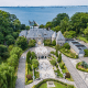 """Asking price: $85 millionF. Scott Fitzgerald lived on Long Island's Kings Point in Great Neck, but modeled the lavish estates in The Great Gatsby after the estates of his neighbors -- including this one. This 14,551 square-foot, 18-bedroom compound on 7.7 waterfront acres in Kings Point was built in 1928, just a year before the stock market crash that started the Great Depression. With views of New York City from its private pier -- which is large enough for a 200-foot yacht -- this estate entices visitors to stroll the grounds and admire the lazy river, outdoor pool with a slide and swim-up bars, tennis court, Japanese-English gardens and koi ponds. Inside of the mansion, guests are pampered with an in-home hair salon and wine-tasting room with a full cellar. The two guest homes are mansions to themselves, sporting indoor pools, a bowling alley a casino and a golf range. A two-level garage comes with its own hydraulic lift and enough space for nine cars. While close enough to New York to be a commuter home, this was clearly built as a """"cottage"""" for those who considered leisure their secondary profession."""