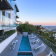 """Asking price: $38,000 a monthWe aren't going to call Josh Altman a """"reality television star,"""" because you don't get this house simply by mugging for Bravo's cameras. Yes, Million Dollar Listing: Los Angeles is just fine, but this real estate agent to the stars can thank his day job for the three-bed, four-bath home he's renting in West Hollywood. He bought it in 2014 for $2.675 million, but the 3,500-square-foot modern home presents far better than the price indicates. The entry gate's call box and smart-home technology protects and entryway with 20-foot ceilings tower overhead and a smoked-glass, 16-pendant chandelier. Calacatta Borghini marble lines the kitchen, while a 150-bottle wine cellar keeps dinner party conversation flowing.If you're thinking of renting this as a vacation house, however, the home's multiple patios and rooftop deck are the big selling points. Overlooking the hills and canyons, roof deck features a outdoor kitchen and custom fire pit. while the lower terrace features a rippling (if narrow) swimming pool. It's a celebrity's house, sure, but compared to some of the other properties we've featured, it's definitely a celebrity real estate agent's getaway."""