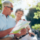 """According to a recent RBC Wealth Management poll, 63% of Americans age 50 and older say travel is an important retirement goal. However, about half say the high cost of travel could prevent them from achieving that goal.Another survey by The Principal found that 20% of U.S. workers said travel blew their budget for 2016, putting its cost on par with food and groceries (20%) and just below dining out (25%). Financial firm UBS, meanwhile, discovered that 73% of Millennials (ages 18-34) focus on short-term needs and goals, such as homes and travel and believe that retirement is too far away to worry about. Nearly 30% have traveled the world for a month or more, more than half with retirement accounts have or would consider dipping into them to make a large purchase and with 25% have already raided their retirement savings for those purchases.""""Everyone is worried about whether they will have saved enough to fund a comfortable retirement,"""" said Tom Sagissor, president of RBC Wealth Management-U.S. """"The closer people get to retirement age, the more they begin to look at needs vs. wants. Often times, because of fear, the needs win out, putting bigger dreams like a trip to Greece or Beijing on hold. But there are many ways to rebalance assets to make travel, if that is indeed a goal, a reality.""""However, age 50 through 65 is when most travel discounts start kicking in. While senior airfare discounts aren't what they once were, they still exist. However, those 10% discounts are outdone by a 15% Amtrak price cut and 20%-50% hotel discounts. If companies want to subsidize your vacations, and we haven't even touched travel company discounts on package tours, why not take the free money they're offering and laugh at all the youngsters overpaying for the same trip.10 Great Ways to Earn Extra Money in RetirementWe Just Debunked These 10 Retirement Myths"""