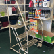 "That tiny sign that says ""Ladders are for employees' use only"" likely will not deter a young customer, perhaps, from climbing on it.Probably the best way to ensure customers don't climb on the ladder, and possibly get hurt and sue the store, is by putting it away."