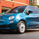 Starting price: $14,995The cinquecento may be a tiny car, but it's now Dodge's Italian cousin and has a whole lot of brawn to live up to. The 500 measures a scant 144 inches long and 64 inches wide, gives parallel parkers a 30.6-inch turning radius for squeezing into tight spots and finds room for 9.5 cubic feet of trunk space The retractable, pool-cover-style sunroof, power outlets, five cup holders, cruise control, power windows and 40 miles-per-gallon highway mileage (and 35.5 mpg overall) are a whole lot cooler to the post-bailout buyer base than gas-guzzling reincarnations of Dodge Charger and Challenger.