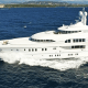 """Cost per week: $400,000This is just your average megayacht tooling around the Central Caribbean these days, but it used to be a lot more famous. Back when Sean """"P. Diddy"""" Combs owned it in the early 2010s, the Lurssen-built Huntress was known as Solemates and was the talk of Saint Barth's -- largely because its custom software allows passengers to order food and control each room's climate, entertainment, lighting and blinds with a swipe on one of 14 complimentary onboard iPads.The Huntress has three levels of decks, two levels of outdoor dining, a covered gym/disco with lights and surround sound and a main salon with a large flat screen TV. The sky lounge features a full bar, space for games and huge corner windows overlooking the sea. The main deck master suite has panoramic views, a mahogany desk, a marble master bath complete with jetted tub and walk-in aromatherapy shower.Below, there are four staterooms with extra-large viewing portholes while the upper deck has the VIP stateroom. When it's time to play, there are two custom tenders to take to shore, waverunners, diving equipment, fishing gear, tandem kayaks, wakeboards, water skis, a towable banana boat and tube and a floating water trampoline. Our favorite perk? Gold clubs with biodegradable golf balls that simply decompose once you mash them into the sea."""