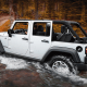 """Starting price: $23,995Miles per gallon: 17 city, 21 highway, 19 mpgThe wind slapping against that soft top in the summer is loud, its combined 19 miles per gallon isn'texactly efficient and it's a little cozy unless you spring for the stretched out Unlimited version. However, that iconic look and off-road performance don't have an acceptable understudy.The ground clearance and four-wheel drive come in awfully handy in miserable winter weather, while that removable hardtop makes it a sweet open-air ride in the summer. Carbuyers don't pick up a used version of the Wrangler, because they want to truck the kids around or make grocery runs. They buy it because they want a """"Jeep"""" and all the fun that comes attached to that name."""