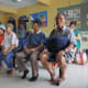 Seniors wait at a health clinic in Malaysia, where the number of doctors is 1.2 per 1,000 people.