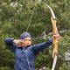 Archery can be done with social distancing and is a sport whose participants are highly attuned to safety measures. USA Archery offers guidelines for safe archery training under Covid-19. They recommend using outdoor ranges, keeping one archer to a target at a time, and wearing masks when not shooting. Shared equipment should be sanitized between uses.
