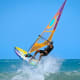Sail offshore on a windy day on your own private board. Before you even start buying equipment, which includes a wetsuit, lifejacket, and board, you should take some lessons on the basics, advises the Cal Sailing Club in Berkeley, Calif.