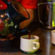Don Juan tour guide pouring freshly made coffee -Don Juan Coffee Farm, Costa Rica