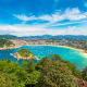 This perfectly crescent-shaped urban beach is in the resort city of San Sebastian in the Basque country of northern Spain. La Concha Beach is easily accessible, clean, and there are lots of bars and restaurants.