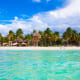 A popular vacation spot, Isla Mujeres is an island just off the coast of Cancun, Mexico. Playa Norte is considered one of the best beaches in all of Mexico. It has soft white sand, palm trees and water so blue it can make the sky look pale.