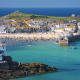 """""""...I met a man with seven wives…"""" Yes, that St. Ives. Located in the county of Cornwall on England's rugged southwestern tip, St. Ives offers golden-sand beaches and sheltered coves great for swimming and sunning, but also surfing, windsurfing and water-skiing."""