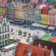 """Known as the """"Polish Venice"""" because of its canals and many bridges that connect 12 islands, Wroclaw sits on the Oder River in western Poland. The Market Square features the Gothic Old Town Hall, with a large astronomical clock."""