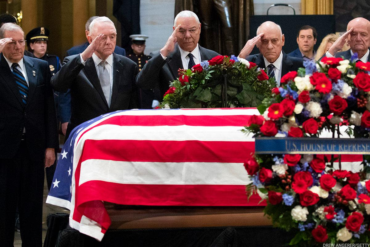 Officers who oversaw the First Gulf War under President George H.W. Bush saluted his casket as it lay in state at the U.S. Capitol. Former Joint Chiefs of Staff head Colin Powell stood at the center.