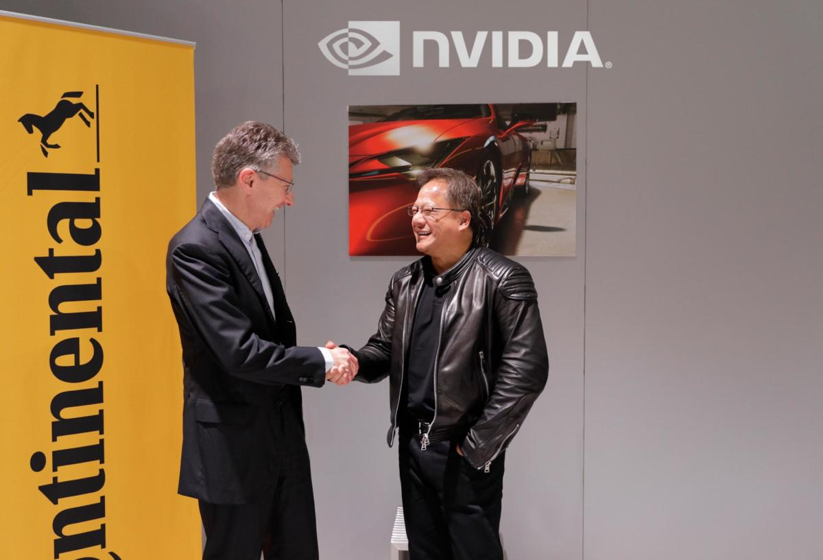Dr. Elmar Degenhart, CEO of Continental and Nvidia founder and CEO Jensen Huang.