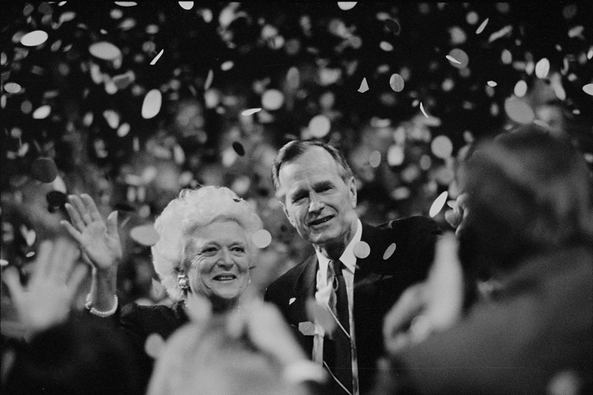 Presidential nominee George H.W. Bush and wife Barbara Bush wave to crowd at the 1992 Republican National Convention in Houston, Texas.