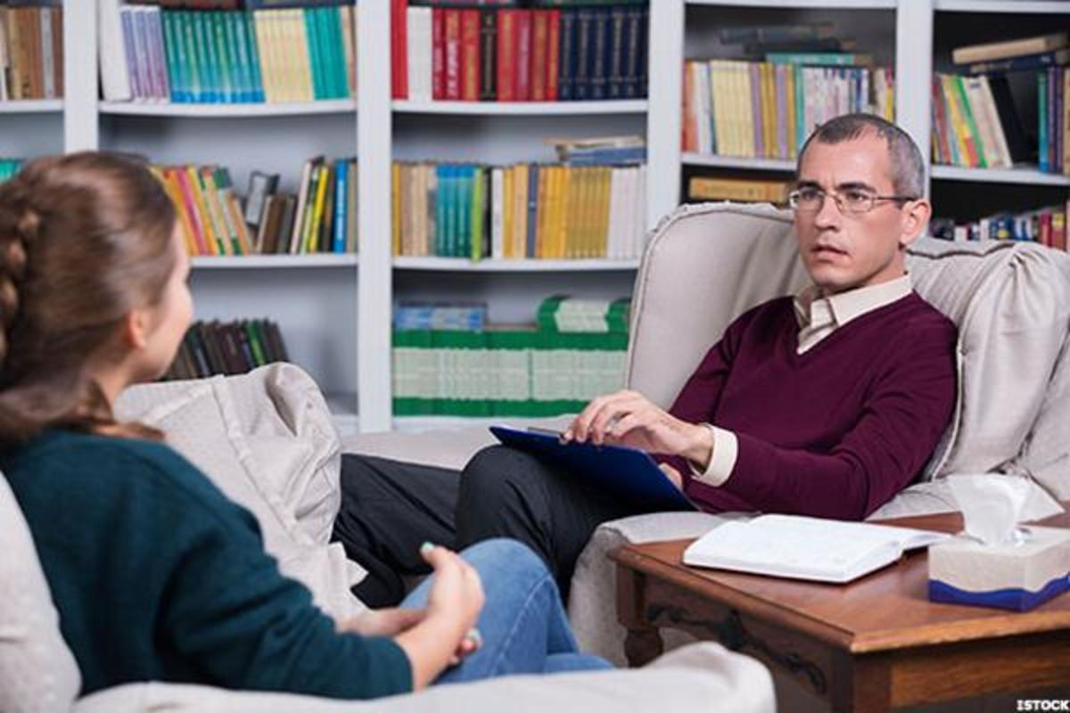 A psychiatrist in a session with a patient