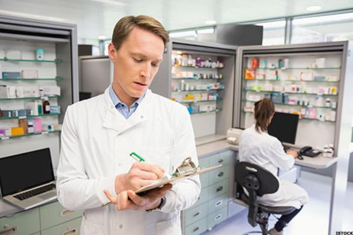 A pharmacist filling out prescriptions