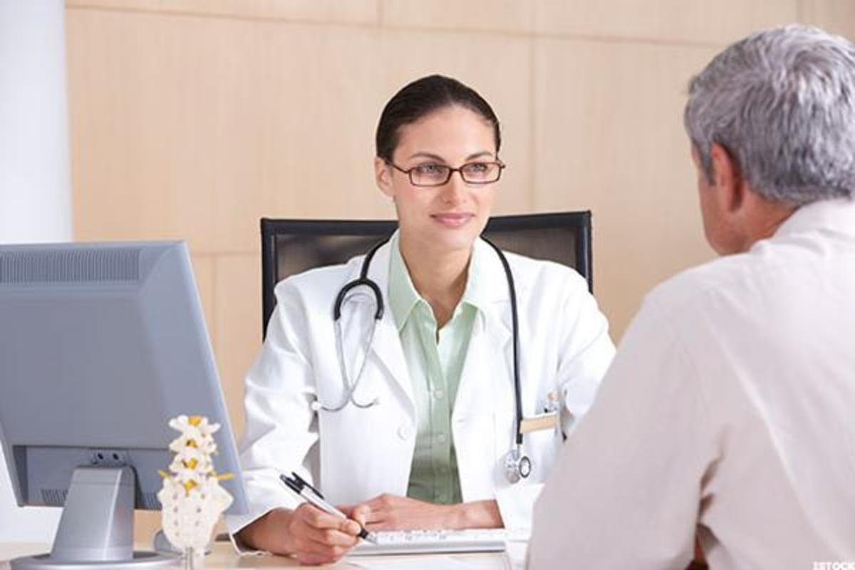 A general physician meeting with a patient