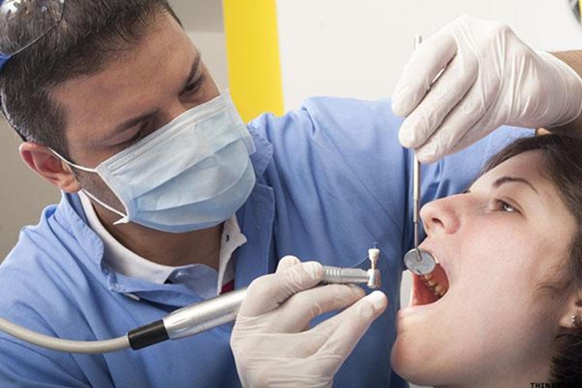 A dentist cleaning teeth