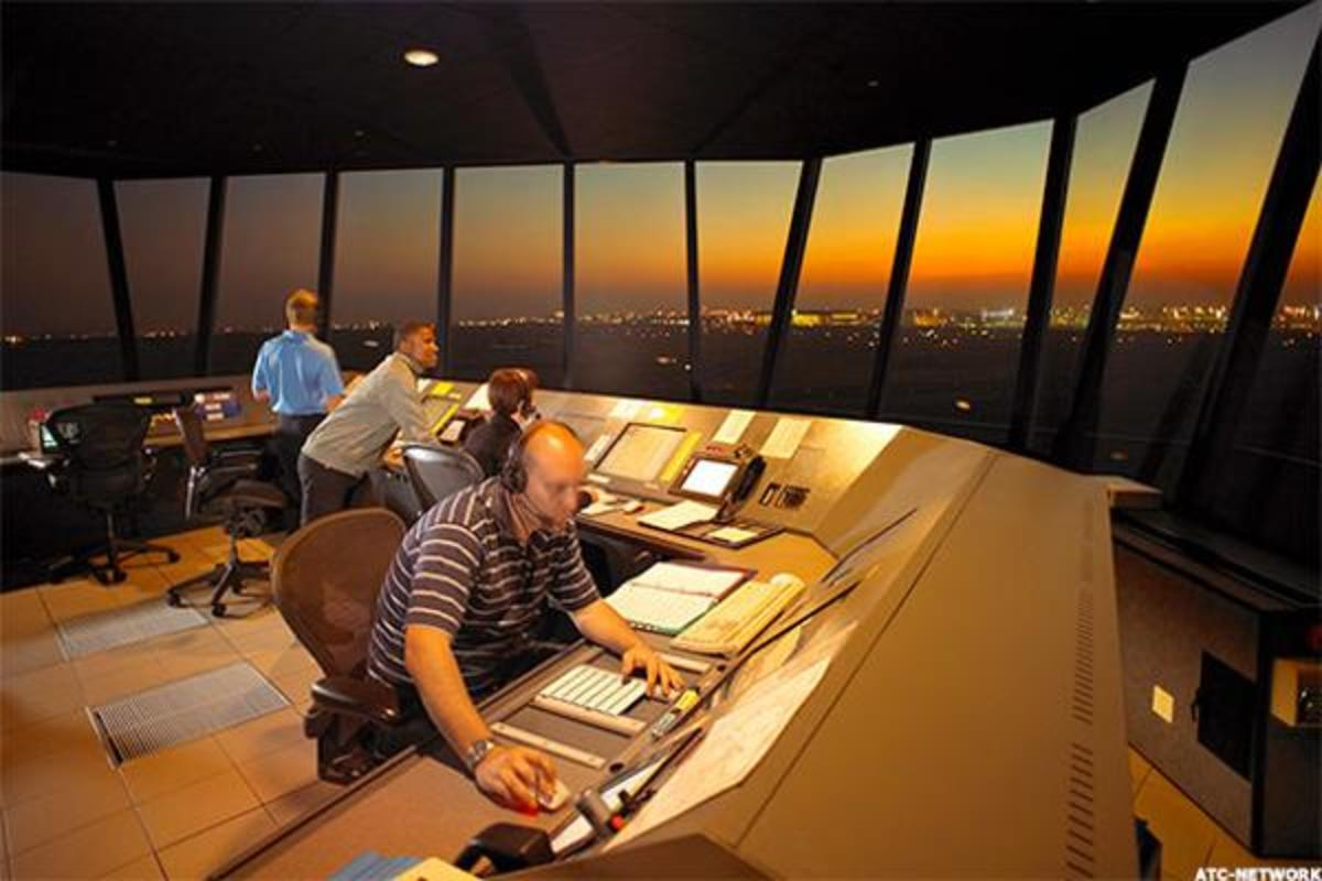 Air traffic controllers in the tower directing flights
