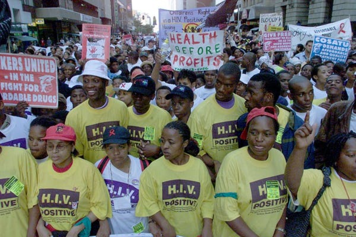 Demonstrators in Durban, South Africa, demand lower priced HIV drugs outside the 2000 international AIDS conference. Yoav Lemmer/AFP via Getty Images