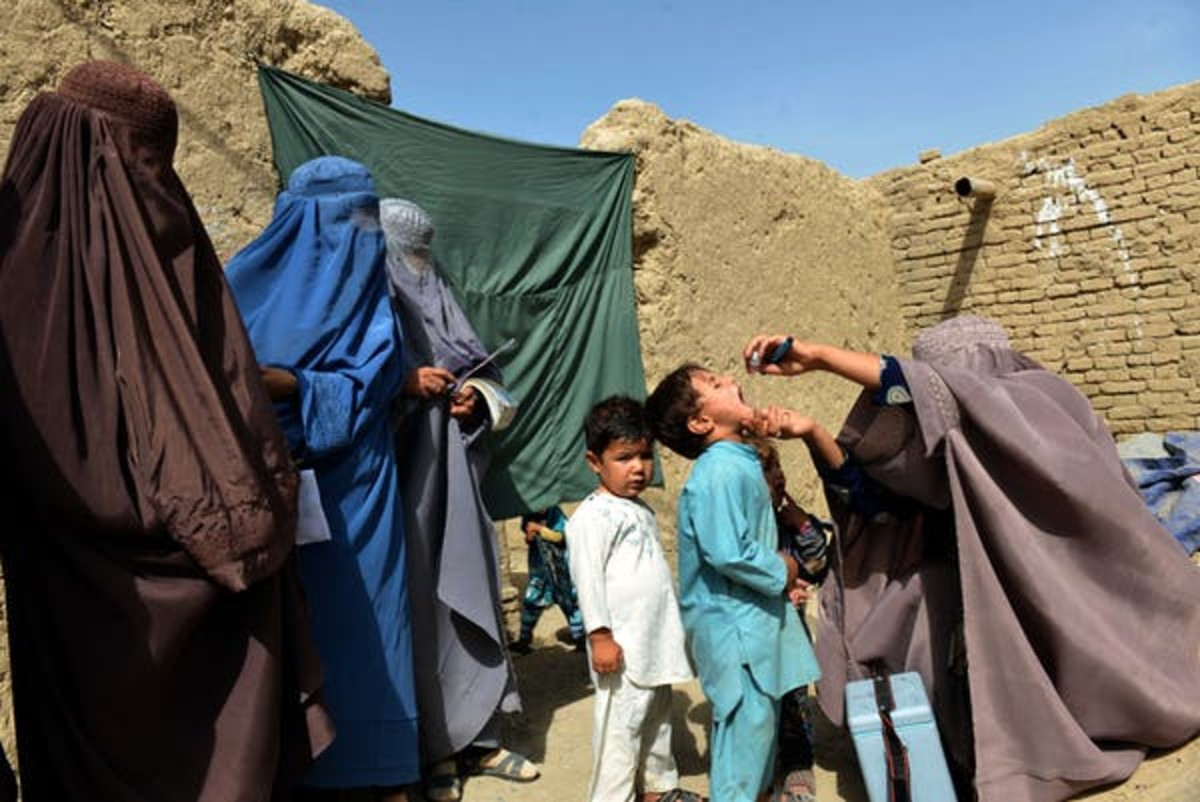 An Afghan health worker administers the polio vaccine to a child in Arghandab, Afghanistan, Aug. 17, 2018. Javed Tanveer/AFP via Getty Images