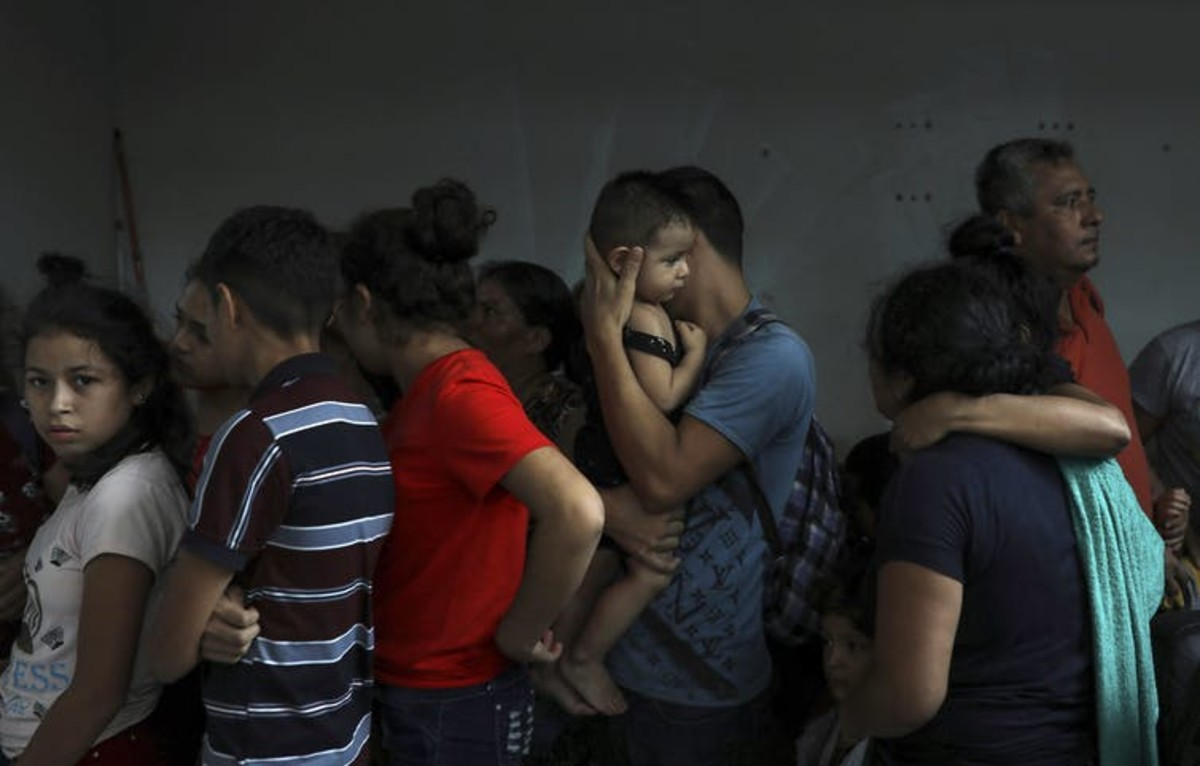 Detained migrants huddle together in a storage room at the back of a hotel where they tried to hide from Mexican immigration agents conducting a raid, in Veracruz, Mexico, in June 2019. Under increasing U.S. pressure to reduce the flow of Central Americans through Mexican territory, Mexico stepped up enforcement. (AP Photo/Felix Marquez)