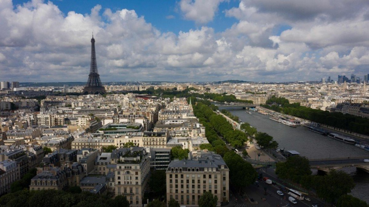 An aerial view of Paris near the Eiffel Tower. A government's handling of the Covid-19 crisis is a key consideration in a relocation decision. Photo: AFP