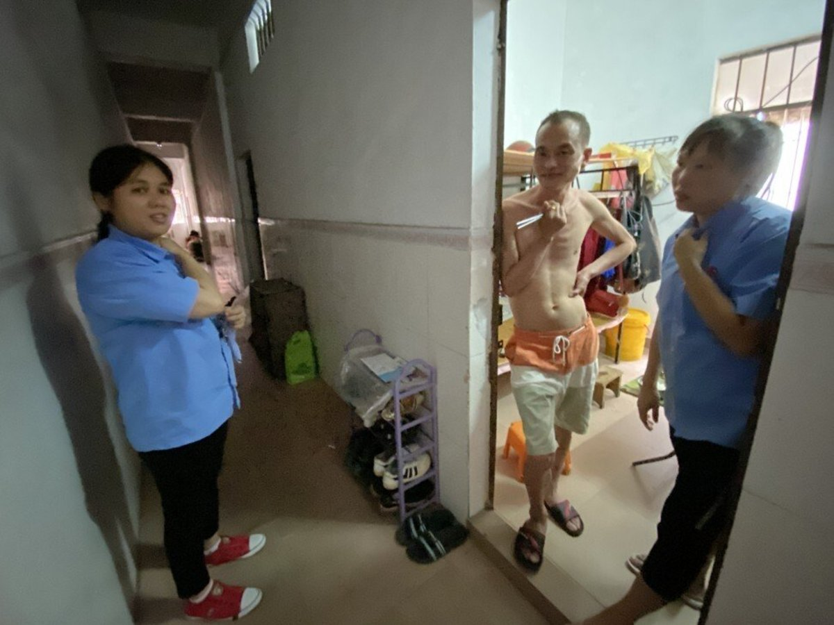 Rao Dequn (right) and her husband live in a 100 sq ft dormitory room. Photo: Huifeng He