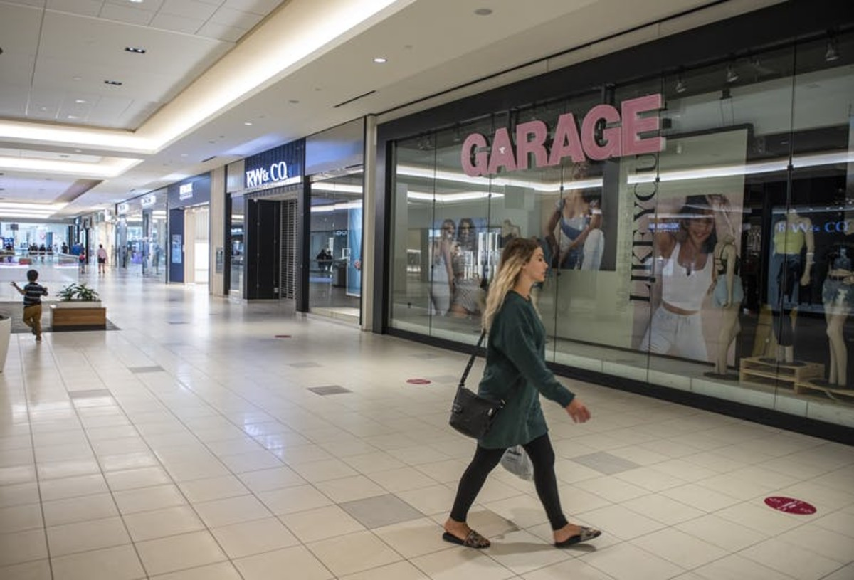 A shopper walks in the relatively empty Bayshore Shopping Centre mall in Ottawa on its first day open as part of Stage 2 of Ontario's plan to lift COVID-19 lockdowns. THE CANADIAN PRESS/Justin Tang