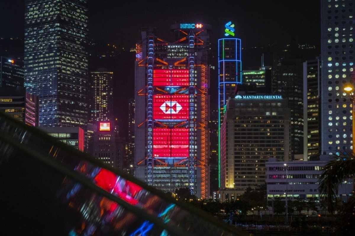 The HSBC Holdings Plc headquarters building stands illuminated in Hong Kong. Photo: Bloomberg