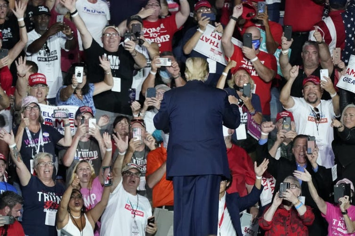 People were packed in close together for Trump's Florida rally on Oct. 12, 2020. Many went without face masks. AP Photos/John Raoux