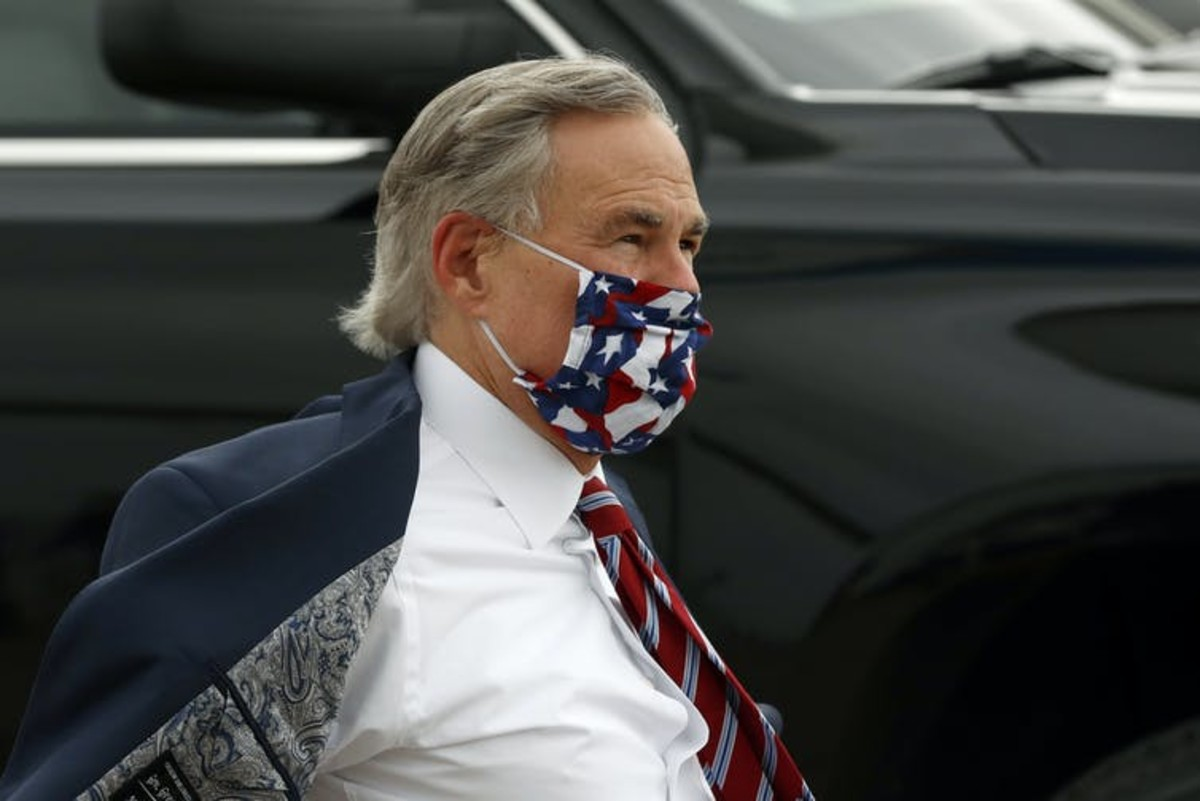 Texas Gov. Greg Abbott, who initially blocked cities from enforcing mask orders, changed his messaging after COVID-19 cases spiked in his state. Many residents had shunned mask-wearing before he shifted to promoting and then requiring it. AP Photo/Tony Guitierrez