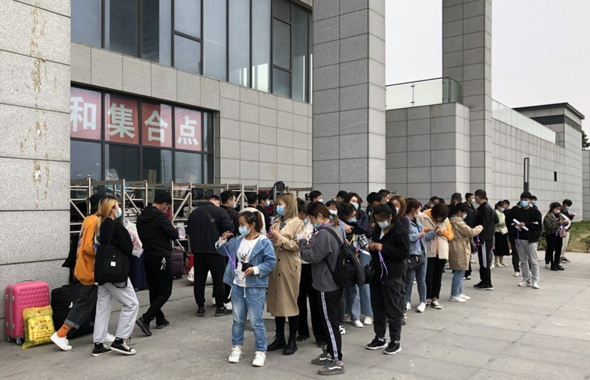 Jobseekers line up outside the world's largest iPhone manufacturing facility, in Zhengzhou, Henan province. Photo: Orange Wang