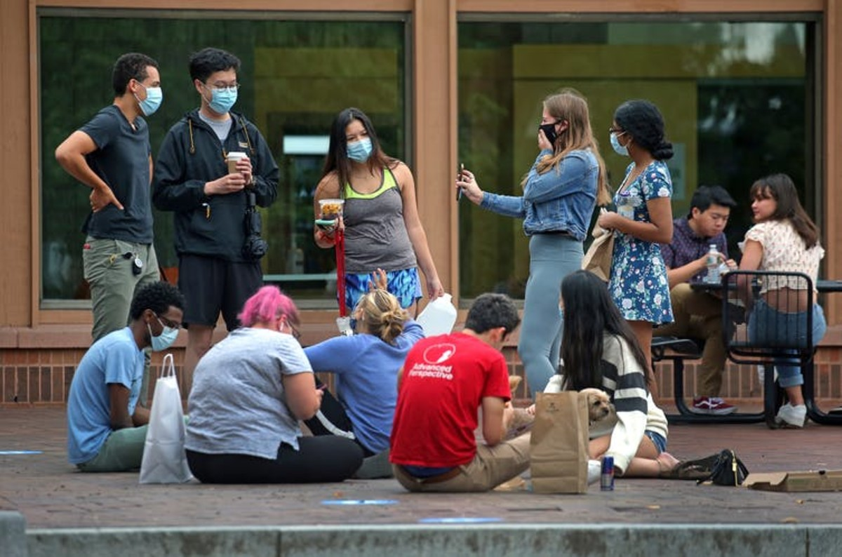 College campuses bring a lot of people together in close proximity, increasing the risk of getting and spreading COVID-19. David L. Ryan/The Boston Globe via Getty Images