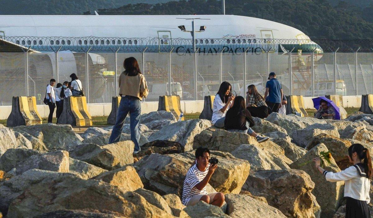 People pose for photographs near Hong Kong International Airport. Photo: Robert Ng