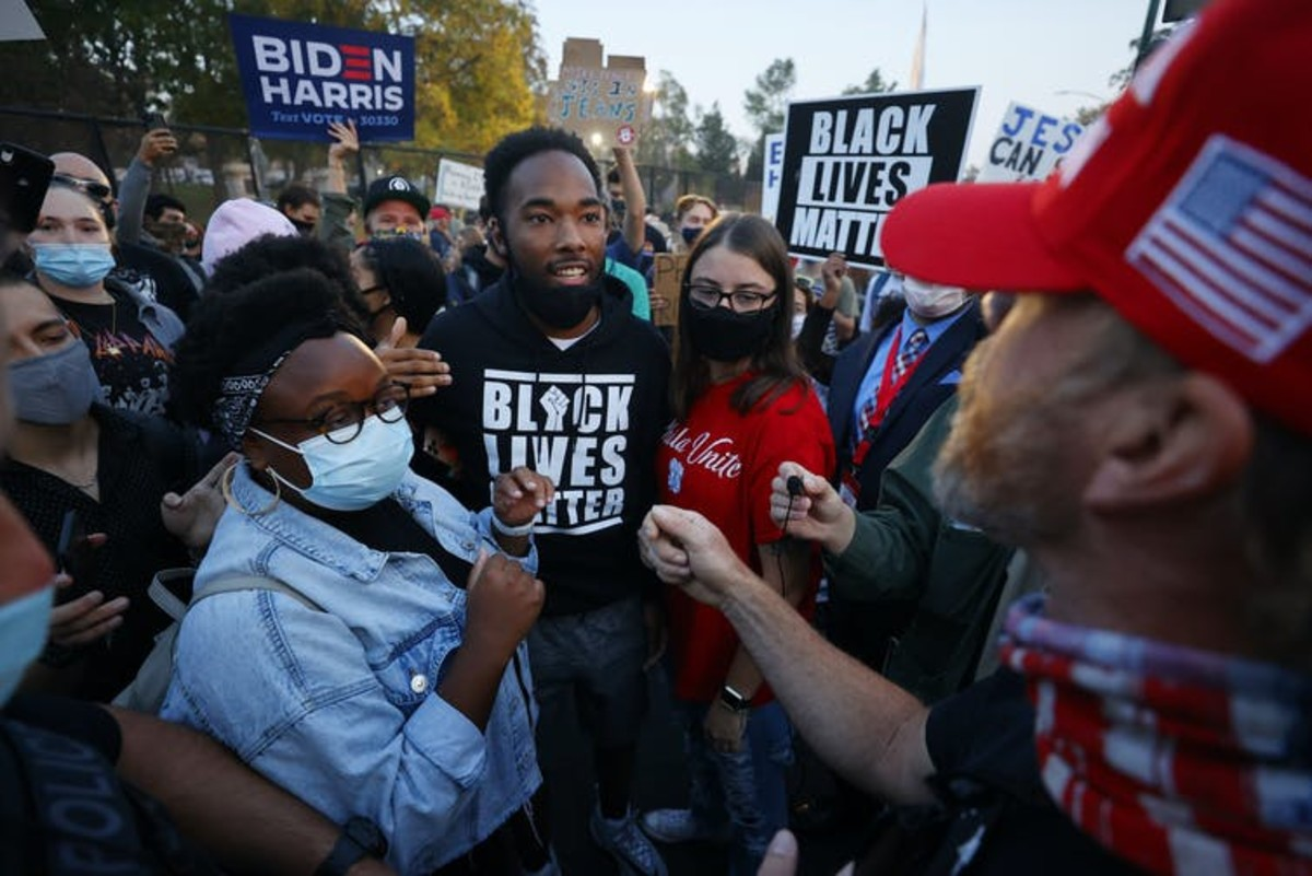 Biden and Trump supporters clash prior to the vice-presidential debate in Salt Lake City on October 7 2020. Jeff Swinger/AP
