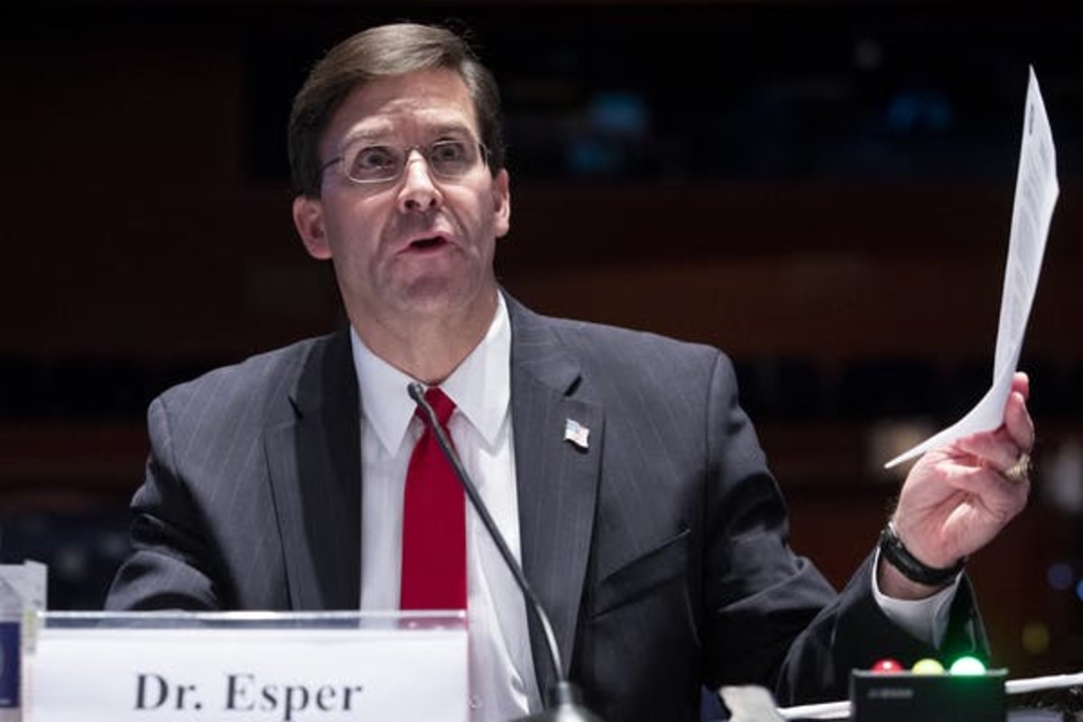 Former U.S. Secretary of Defense Mark Esper was reportedly fired for opposing Trump's Afghanistan troop withdrawal. Michael Reynolds-Pool/Getty Images)