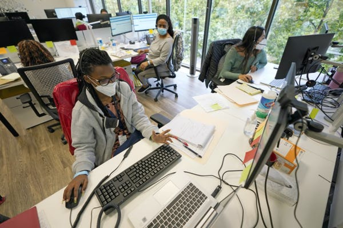 Counties have hired more contact tracers trained to conduct interviews, but the rising case numbers and amount of time required for each case have overwhelmed them. AP Photo/David J. Phillip