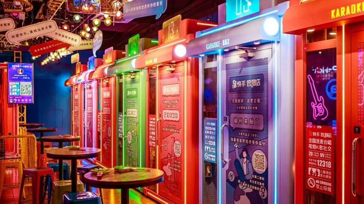 Kuaishou opens a karaoke store in Guangzhou where customers can either sing on a public stage or entertain themselves in a soundproof cubicle equipped with a screen, microphones and earphones. Photo: Handout