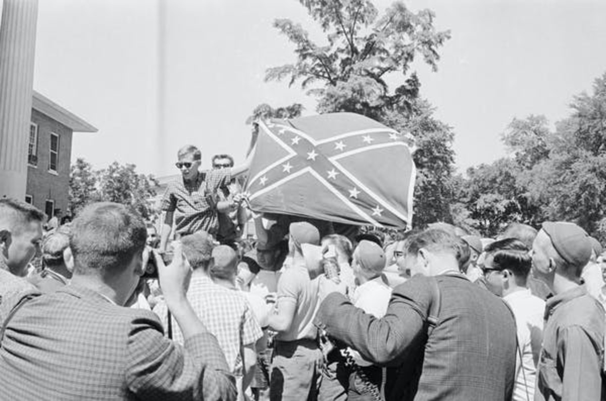 Rioting white students at University of Mississippi hoist a Confederate battle flag in a backlash against James Meredith's attendance as the first Black student in 1962. Bettman via Getty Images