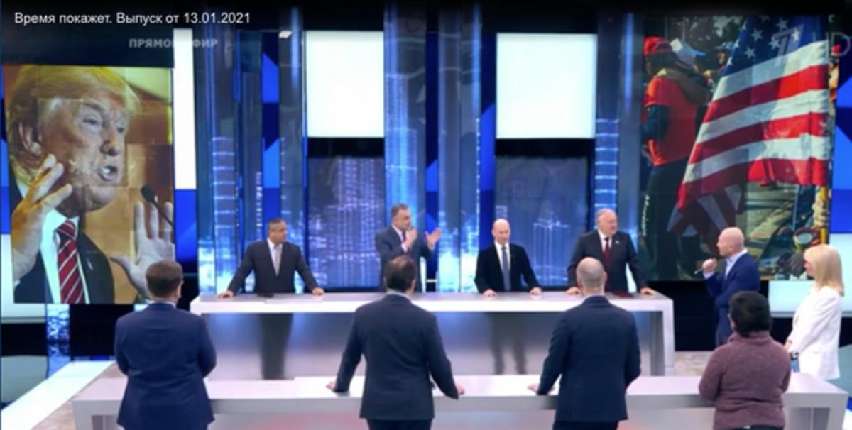 Hosts of 'Time Will Tell,' a pro-Kremlin news talk show, discuss the U.S. Capitol siege on Jan. 13, 2021.