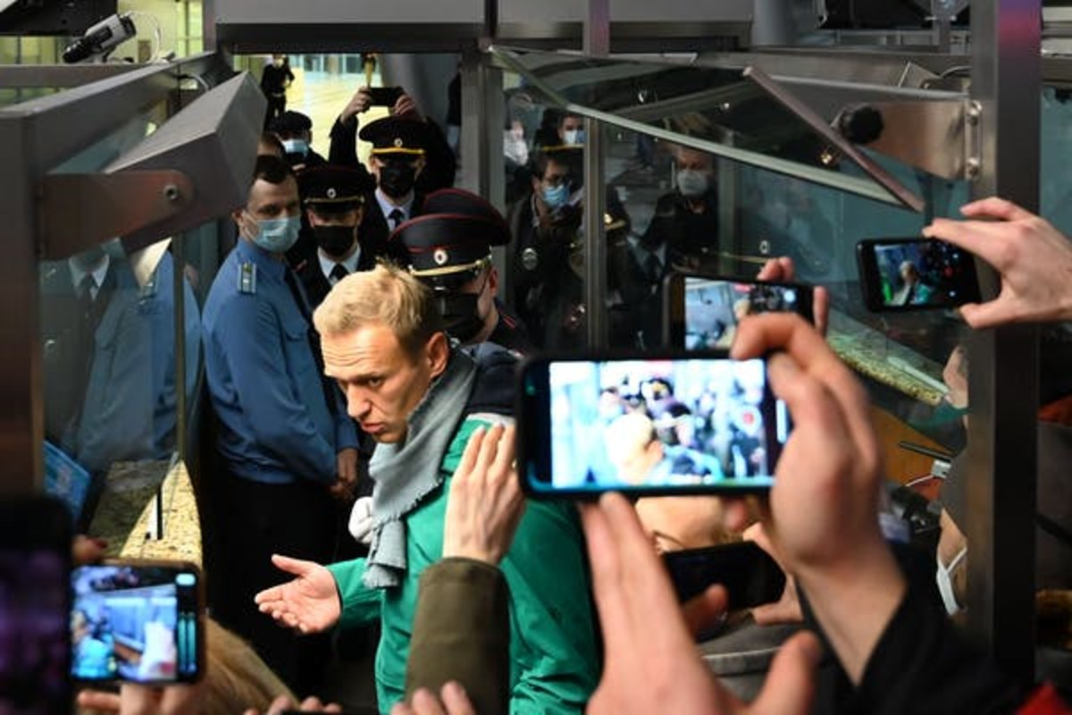 Alexei Navalny is seen at the passport control point at Moscow's Sheremetyevo airport on Jan. 17; he was then arrested by Russian police. Kirill Kudryavtsev/AFP via Getty Images)
