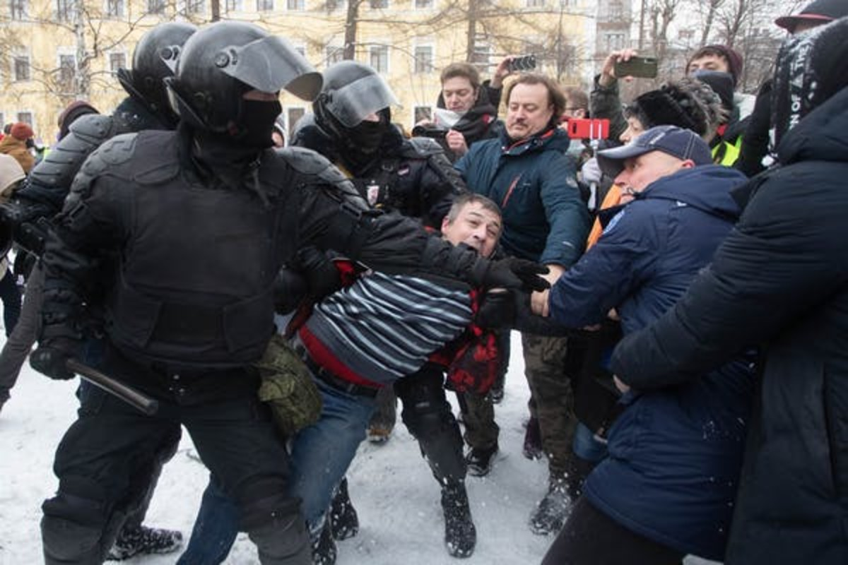 Riot police officers detain a man during a rally in support of jailed Russian opposition leader Alexei Navalny in Saint Petersburg, Russia, on Jan. 31. Anatolij Medved/NurPhoto via Getty Images