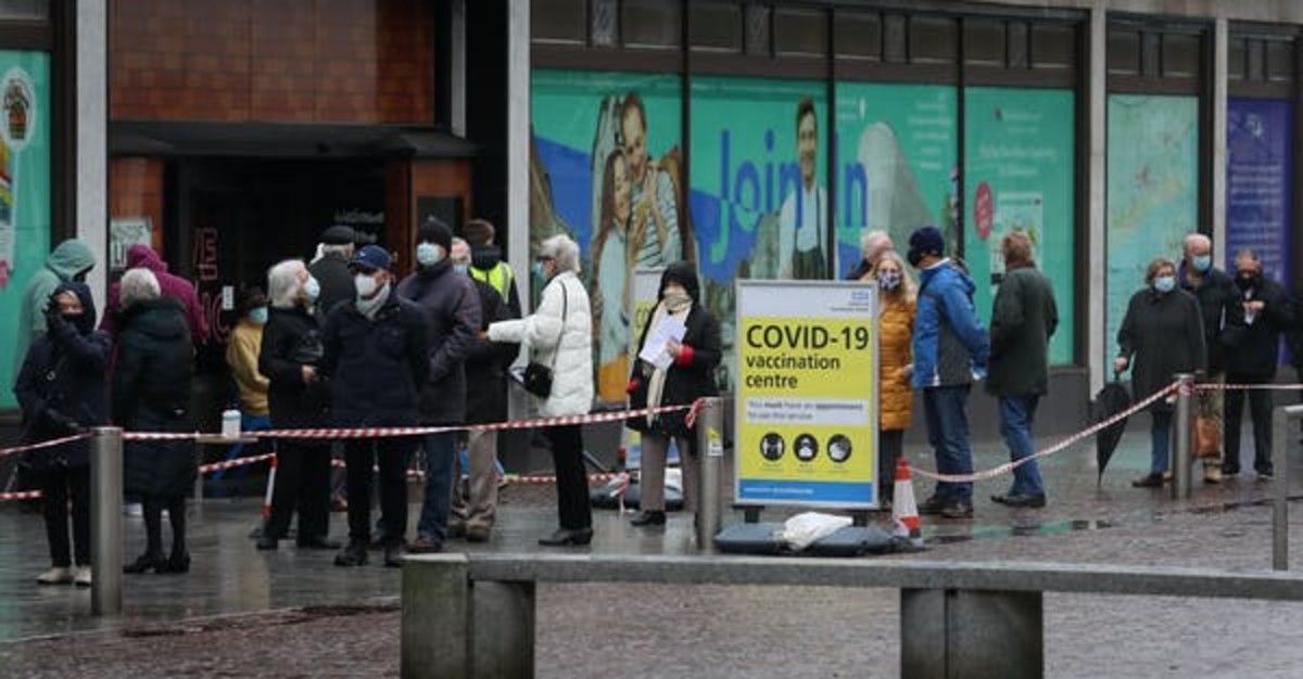 People wait for a COVID-19 vaccine during England's third national lockdown to curb the spread of coronavirus. Gareth Fuller/PA Images via Getty Images